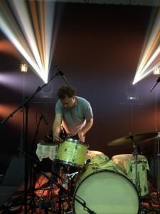 Jamie tweaking his gear during rehearsal.
